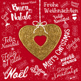 Merry Christmas greetings card from world in different languages. With golden heart, calligraphic text and font handwritten lettering Stock Image