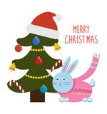 Merry Christmas Greetings Cartoon Hare Rabbit Tree. Merry Christmas greetings from cartoon bunny rabbit in pink scarf sitting under decorated Christmas tree with Stock Photos