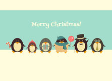 Merry Christmas greetings with penguins Stock Images