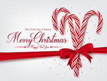 Merry Christmas Greetings in Realistic 3D Candy Cane. And Christmas Balls in Background. Vector Illustration Stock Photography