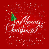 Merry Christmas greetings white ribbon lettering over festive red background with christmas tree Stock Photo