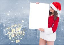 Merry christmas greetings with woman holding blank placard Stock Photos