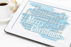 Merry Christmas greetings word cloud on tablet Royalty Free Stock Photo