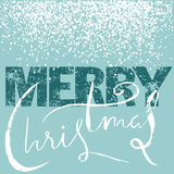 Merry Christmas grunge lettering design on blue background with white snow. Holiday lettering card. Stock Photo