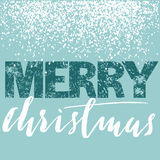Merry Christmas grunge lettering design on blue background with white snow. Holiday lettering card. Stock Photos