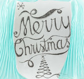 Merry Christmas hand drawn lettering design framed by cyan curta Stock Photos