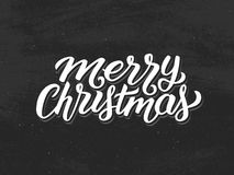 Merry Christmas hand lettering on chalkboard Royalty Free Stock Images