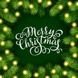 Merry Christmas hand lettering inscription with frame of fir branches Stock Image