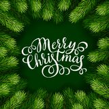 Merry Christmas hand lettering inscription with frame of fir branches Stock Photos