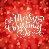Merry Christmas hand lettering inscription on red bokeh light background. Hand drawing calligraphy phrases for greeting card, poster, banner, website, header Royalty Free Stock Images