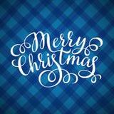 Merry Christmas hand lettering inscription on tartan pattern Stock Photo