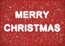 Merry Christmas hand writting text. On red background with snowflakes royalty free stock photos