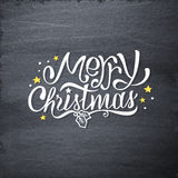 Merry Christmas handdrawn greetings on chalkboard Stock Photos