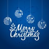 Merry Christmas. Handdrawn inscription for greeting card or invitation.. Hand written lettering. Holiday design. Winter background with christmas balls Royalty Free Stock Photos