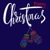 Merry Christmas. Handdrawn lettering for Christmas cards and posters. Mitten pair on a string. Royalty Free Stock Images