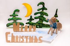 Merry Christmas and handmade horse Stock Photography