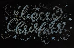 Merry Christmas handwritten calligraphic inscription on a gray wall texture. wall texture and paint. rastr.  Stock Photos