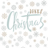 Merry Christmas handwritten lettering design with gold and silver snowflakes on white background. EPS10 Royalty Free Stock Photo