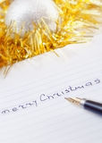 Merry Christmas handwritten message. On notebook Royalty Free Stock Photos