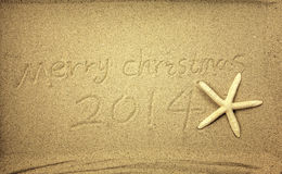 Merry Christmas handwritten in sand Stock Photography