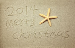 Merry Christmas 2014 handwritten in sand Stock Photography