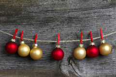 Merry Christmas Hanging Decoration Red and Gold Bulbs and Red Cl Royalty Free Stock Photography