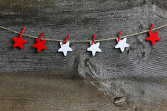 Merry Christmas Hanging Decoration Red and White Wooden Stars royalty free stock photography