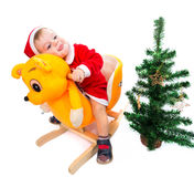 Merry Christmas from happy baby Stock Images