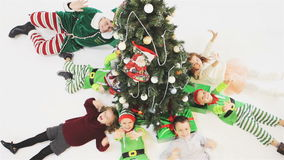Merry Christmas 2016. Happy children celebrating Christmas. Merry Christmas 2016. Video footage of happy children celebrating Christmas lying near Cristmas tree stock video