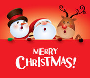 Merry Christmas! Happy Christmas companions with big sign. Royalty Free Stock Photo