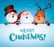 Merry Christmas! Happy Christmas companions with big sign. Royalty Free Stock Image