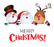 Merry Christmas! Happy Christmas companions with big sign. Royalty Free Stock Photos