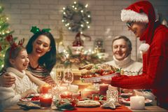 Family celebrates Christmas. Royalty Free Stock Images