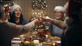 Family celebrating Christmas, dinner at home. Merry Christmas! Happy family are having dinner at home. Celebration holiday and togetherness near tree stock footage