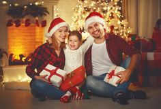 Merry Christmas! happy family mother father and child with magic Stock Image