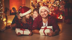Merry Christmas! happy family mother father and child with magic Stock Photo