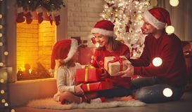 Merry Christmas! happy family mother father and child with magic Stock Images