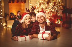 Merry Christmas! happy family mother father and child with magic Royalty Free Stock Photo