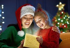 Family with magic gift box. Merry Christmas and Happy Holiday! Loving family mother and child with magic gift box Royalty Free Stock Photography
