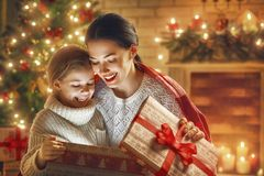 Family with magic gift box. Merry Christmas and Happy Holiday! Loving family mother and child with magic gift box Stock Photo