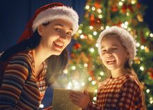 Family with magic gift box. Merry Christmas and Happy Holiday! Loving family mother and child with magic gift box Stock Images