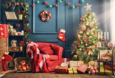 Room decorated for Christmas. Merry Christmas and Happy Holidays! A beautiful living room decorated for Christmas stock photos