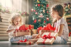 Girls opening gifts Stock Photos
