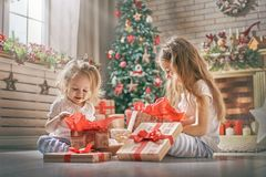 Girls opening gifts Royalty Free Stock Images