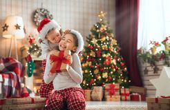 Girls opening Christmas gifts royalty free stock image