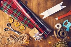 Merry Christmas and Happy Holidays! Christmas preparation, sciss. Ors, ribbons, stationery knife, sellotape stock photography
