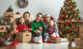 Family preparing for Christmas stock images
