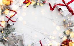 Christmas and New Year holiday background. Xmas greeting card. Winter holidays. Merry Christmas and Happy Holidays greeting card, frame. New Year. Red, silver royalty free stock photography
