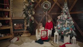 Merry Christmas and Happy New Year. Mom and son decorate the Christmas tree indoors. Loving family close up. Merry Christmas and Happy Holidays Mom and son stock video footage