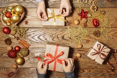 Merry Christmas and Happy Holidays. A mother and son prepare Xmas gifts. Top view. Christmas family traditions stock photography